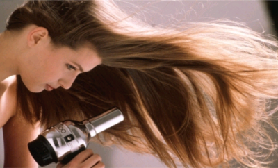 woman blow dry hair