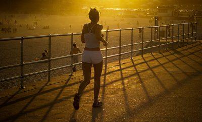 woman running near the beach at sunset