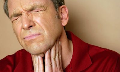 man suffering from tonsil stones