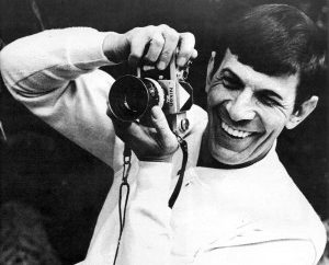 Leonard Nimoy taking a picture and smiling