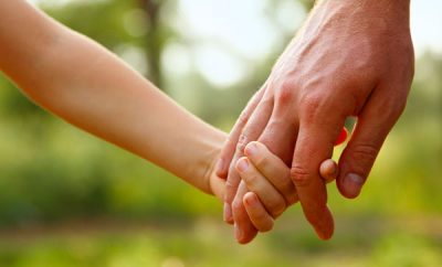 parent holding child's hands