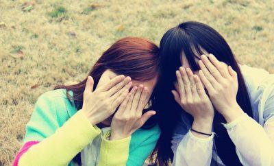 girls covering their eyes