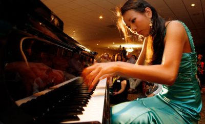 Asian woman playing piano