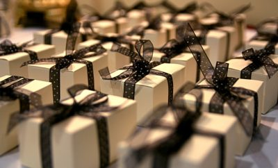 gold presents wrapped in black ribbon