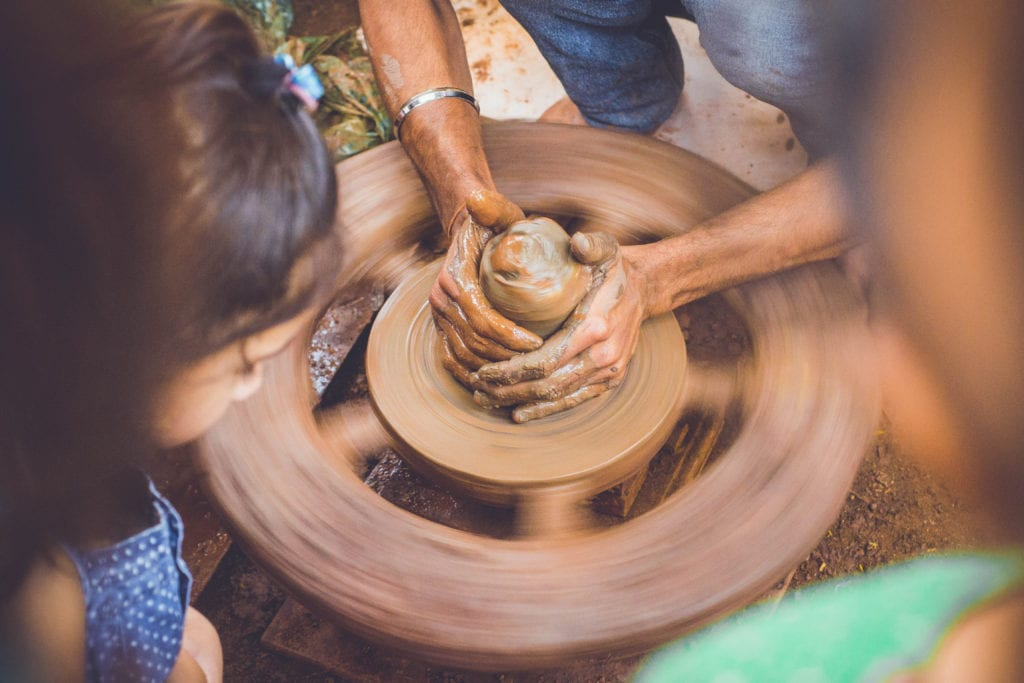 hands making pottery while thinking about what to do with your life