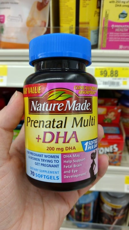 hand holding Nature Made prenatal vitamins to maintain a beauty regime