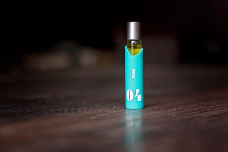 bottle of essential oils on hardwood floor used to stay fresh