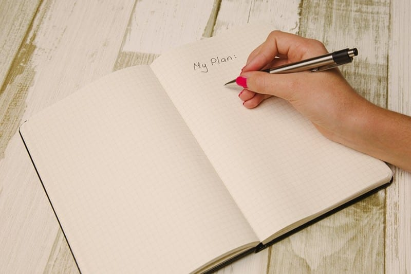 hand writing in planner during morning routines