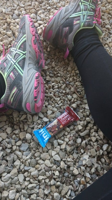 INIT bars laying in between feet on gravel during an everyday adventure